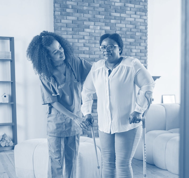 caregiver helping a disabled woman