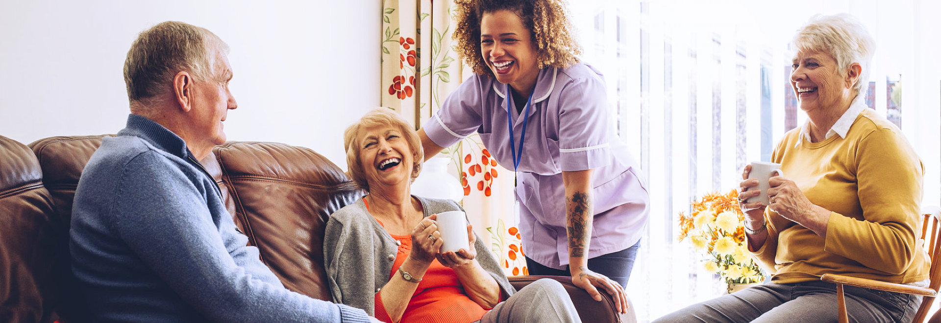 group of senior and a caregiver having a good time
